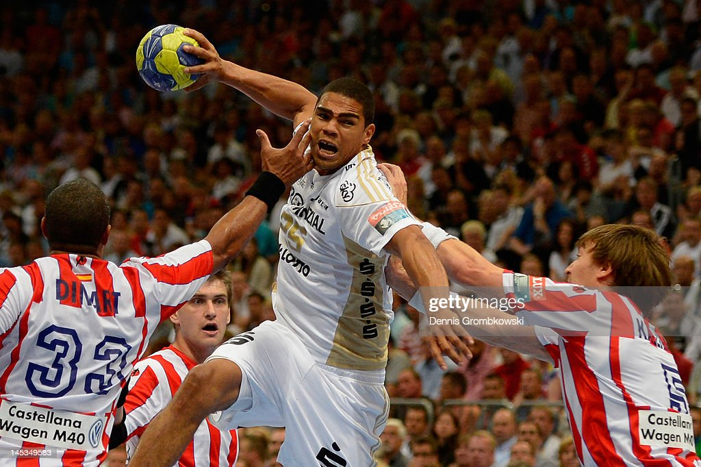 Didier Dinart of Madrid and teammate Jonas Kaellmann challenge Daniel Narcisse of Kiel during the EHF Final Four final match between THW Kiel and BM Atletico Madrid at Lanxess Arena on May 27, 2012 in Cologne, Germany.