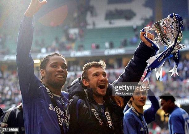 Didier Drogba and Andriy Shevchenko of Chelsea celebrate with the trophy following their team's victory at the end of the Carling Cup Final match...