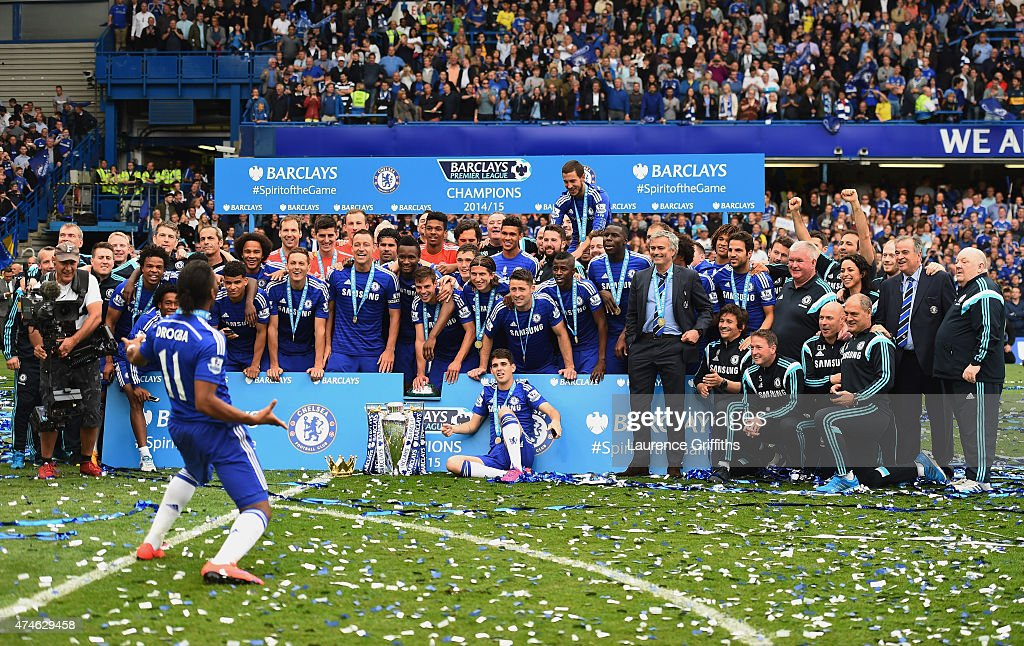 Didier Drogba and Chelsea players and staffs celebrate winning the Premier League title after the Barclays Premier League match between Chelsea and Sunderland at Stamford Bridge on May 24, 2015 in London, England.