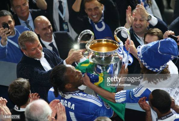 Didier Drogba and club owner Roman Abramovich celebrate with the trophy after their victory in the UEFA Champions League Final between FC Bayern...