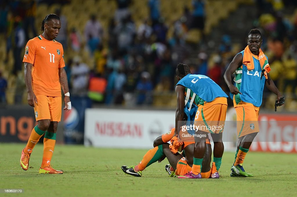 <a gi-track='captionPersonalityLinkClicked' href=/galleries/search?phrase=Didier+Drogba&family=editorial&specificpeople=179398 ng-click='$event.stopPropagation()'>Didier Drogba</a> (L) and his teammates of Ivory Coast look dejected after the 2013 Orange African Cup of Nations 3rd Quarter Final match between Ivory Coast and Nigeria, at Royal Bafokeng Stadium on February 03, 2013 in Rustenburg, South Africa.