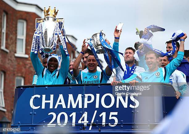 Didier Drogba and John Terry hold up the Premier League trophy and League Cup trophy as they exit the stadium during the Chelsea FC Premier League...