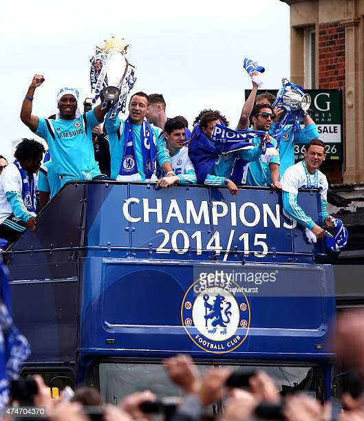 Didier Drogba and John Terry hold up the Premier League trophy during the Chelsea FC Premier League Victory Parade on May 25 2015 in London England