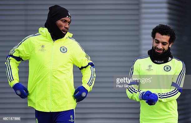 Didier Drogba and Mohamed Salah attempt to keep warm during a Chelsea training session ahead of the UEFA Champions League Group G match against...