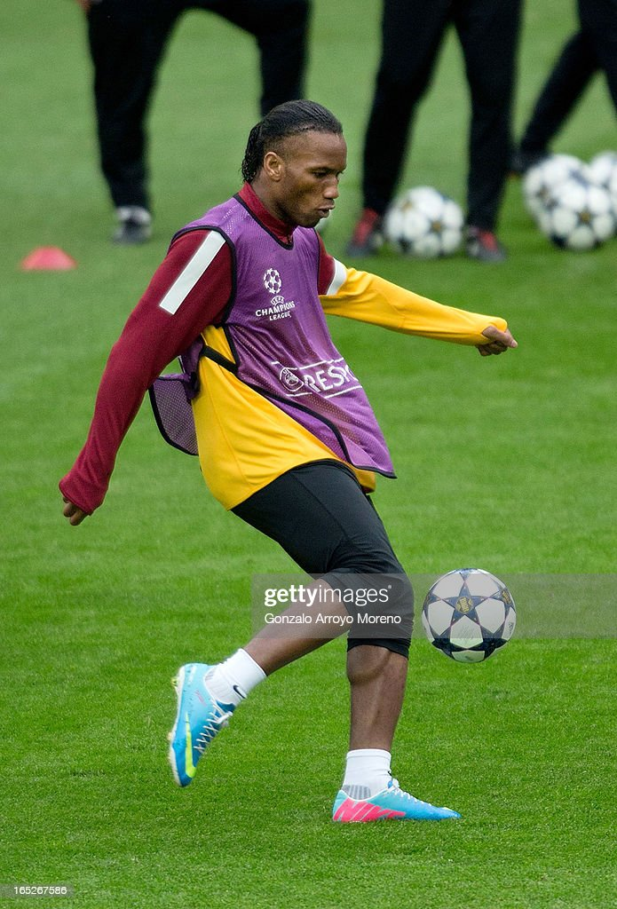 <a gi-track='captionPersonalityLinkClicked' href=/galleries/search?phrase=Didier+Drogba&family=editorial&specificpeople=179398 ng-click='$event.stopPropagation()'>Didier Drogba</a> excersises during a training session ahead of the UEFA Champions League Quarterfinal match between Real Madrid and Galatasaray AS at Estadio Santiago Bernabeu on April 2, 2013 in Madrid, Spain.