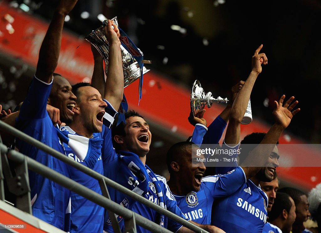 Didier Drogba, John Terry, Frank Lampard, Florent Malouda and Jose Bosingwa of Chelsea celebrate winning the FA Cup Final with Budweiser between Liverpool and Chelsea at Wembley Stadium on May 5, 2012 in London, England.