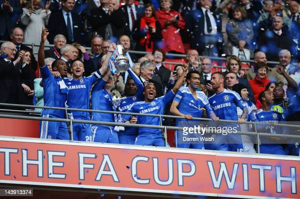 Didier Drogba John Terry Frank Lampard Florent Malouda and Jose Bosingwa of Chelsea celebrate with team mates as they lift the FA Cup trophy during...