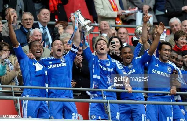Didier Drogba John Terry Frank Lampard Florent Malouda and Jose Bosingwa of Chelsea celebrate with the FA Cup after victory over Liverpool in the FA...