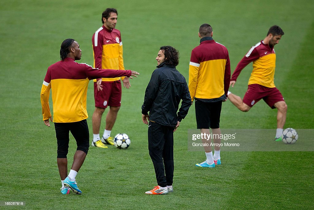 <a gi-track='captionPersonalityLinkClicked' href=/galleries/search?phrase=Didier+Drogba&family=editorial&specificpeople=179398 ng-click='$event.stopPropagation()'>Didier Drogba</a> (L) jokes with teammates and a member of the technical staff during a training session ahead of the UEFA Champions League Quarterfinal match between Real Madrid and Galatasaray AS at Estadio Santiago Bernabeu on April 2, 2013 in Madrid, Spain.