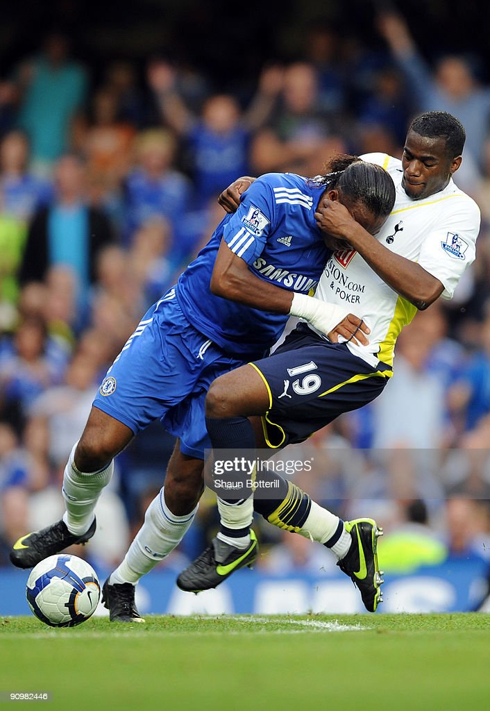Didier Drogba of Chelsea battles for the ball with Sebastien Bassong of Tottenham Hotspur during the Barclays Premier League match between Chelsea...