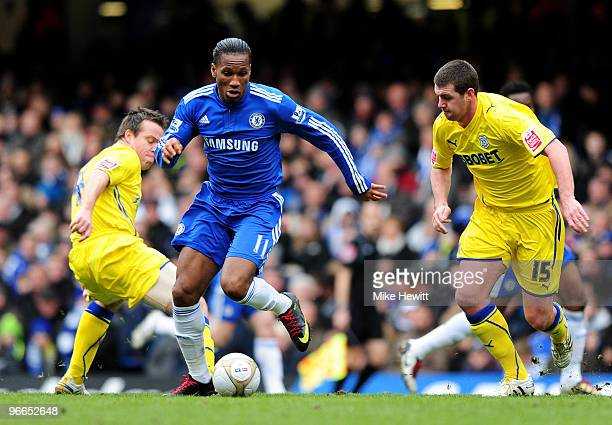 Didier Drogba of Chelsea bursts between Gavin Rae and Anthony Gerrard of Cardiff during the Eon sponsored FA Cup 5th Round match between Chelsea and...