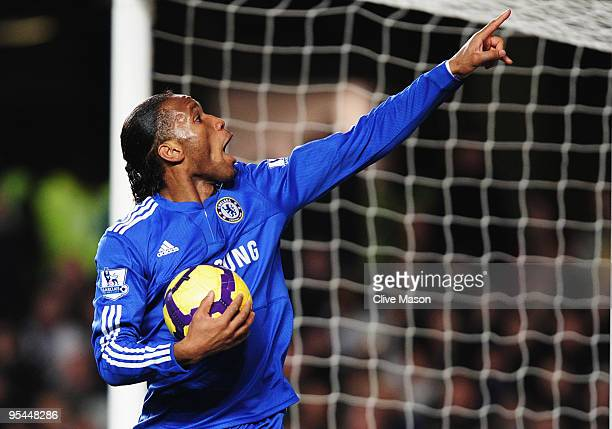 Didier Drogba of Chelsea celebrates as he scores their first goal during the Barclays Premier League match between Chelsea and Fulham at Stamford...