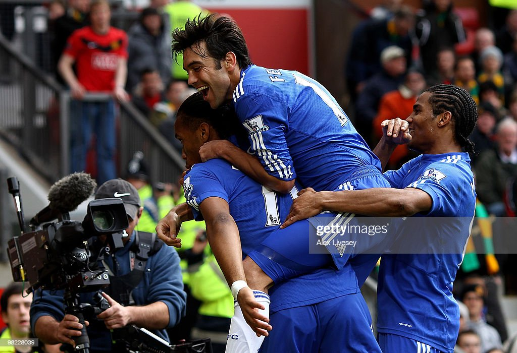 <a gi-track='captionPersonalityLinkClicked' href=/galleries/search?phrase=Didier+Drogba&family=editorial&specificpeople=179398 ng-click='$event.stopPropagation()'>Didier Drogba</a> of Chelsea celebrates scoring his team's second goal with his team mates during the Barclays Premier League match between Manchester United and Chelsea at Old Trafford on April 3, 2010 in Manchester, England.