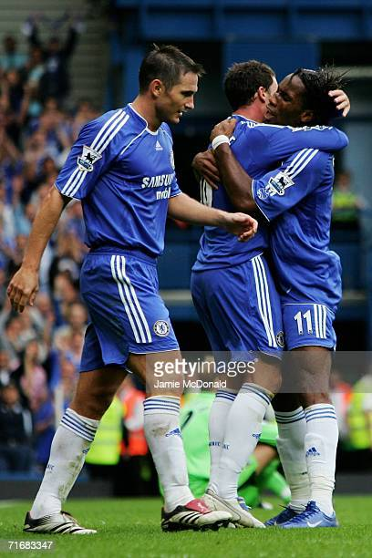 Didier Drogba of Chelsea celebrates scoring the third goal of the game with team mate Wayne Bridge during the Barclays Premiership match between...