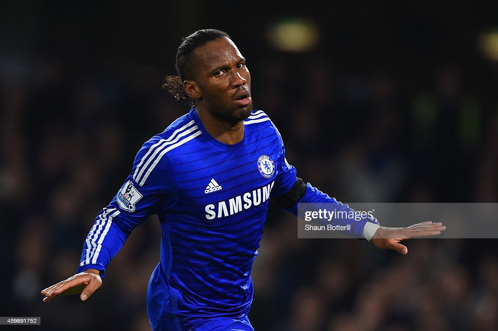Didier Drogba of Chelsea celebrates scoring their second goal during the Barclays Premier League match between Chelsea and Tottenham Hotspur at Stamford Bridge on December 3, 2014 in London, England.