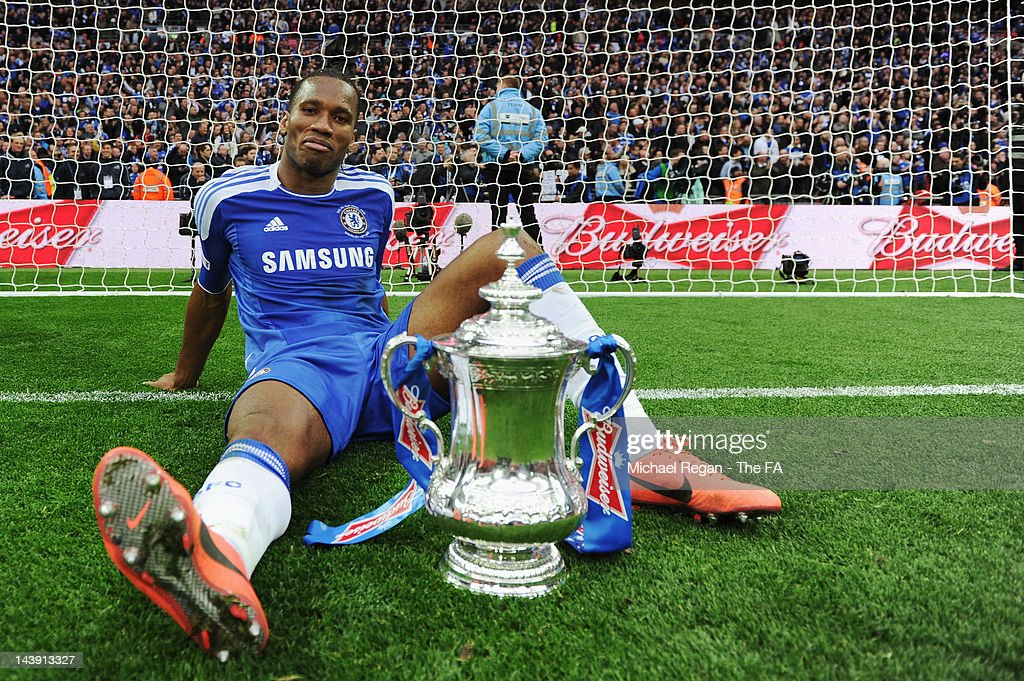 <a gi-track='captionPersonalityLinkClicked' href=/galleries/search?phrase=Didier+Drogba&family=editorial&specificpeople=179398 ng-click='$event.stopPropagation()'>Didier Drogba</a> of Chelsea celebrates victory with the trophy in the FA Cup Final with Budweiser between Liverpool and Chelsea at Wembley Stadium on May 5, 2012 in London, England.