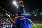 Didier Drogba of Chelsea celebrates with team mates after scoring his team's first goal during UEFA Champions League Final between FC Bayern Muenchen...