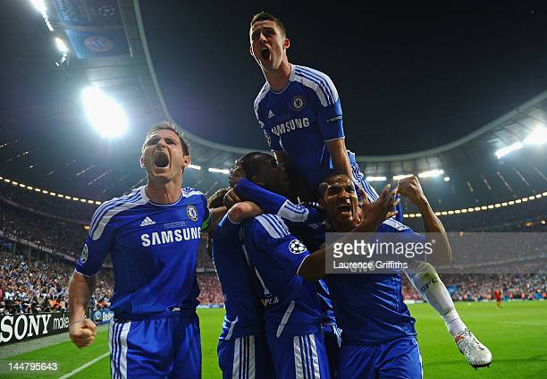 Didier Drogba of Chelsea celebrates with team mates Frank Lampard and Gary Cahill after scoring his team's first goal during UEFA Champions League...