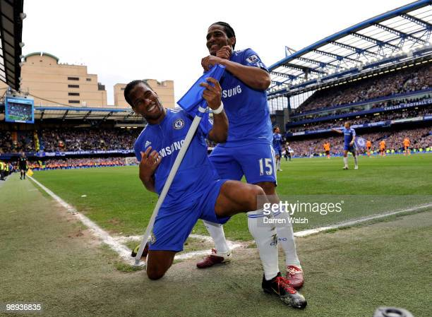 Didier Drogba of Chelsea celebrates with teammate Florent Malouda after completing his hat trick and scoring his team's seventh goal during the...