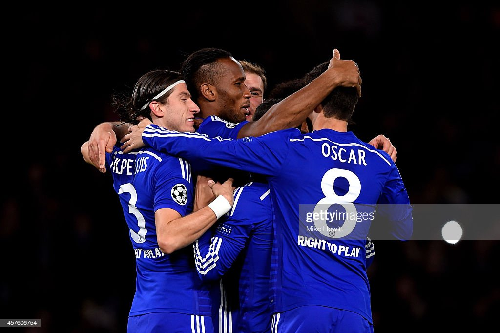 Didier Drogba (C) of Chelsea celebrates with teammates after scoring his team's second goal from the penalty spot during the UEFA Champions League Group G match between Chelsea FC and NK Maribor at Stamford Bridge on October 21, 2014 in London, United Kingdom.