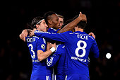 Didier Drogba of Chelsea celebrates with teammates after scoring his team's second goal from the penalty spot during the UEFA Champions League Group...