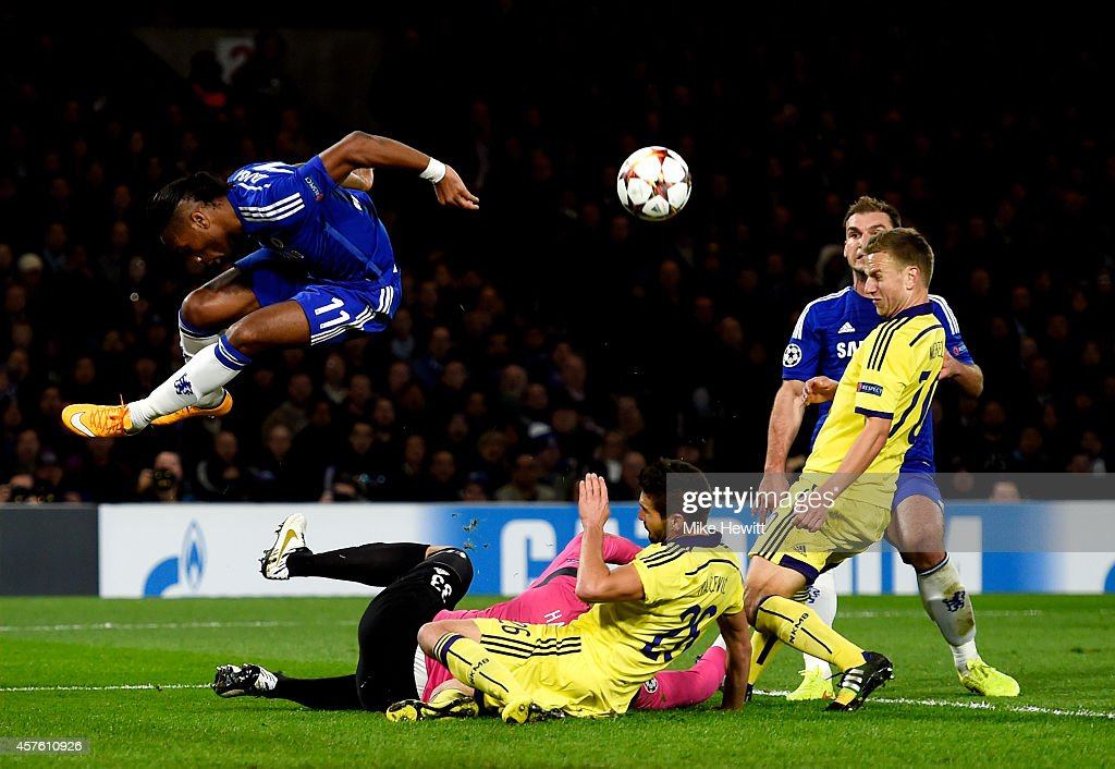 Didier Drogba of Chelsea hurdles over goalkeeper Jasmin Handanovic of Maribor during the UEFA Champions League Group G match between Chelsea FC and NK Maribor at Stamford Bridge on October 21, 2014 in London, United Kingdom.