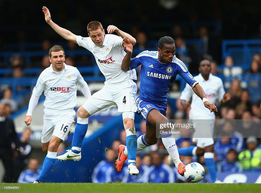 <a gi-track='captionPersonalityLinkClicked' href=/galleries/search?phrase=Didier+Drogba&family=editorial&specificpeople=179398 ng-click='$event.stopPropagation()'>Didier Drogba</a> of Chelsea is challenged by James McCarthy of Wigan Athletic during the Barclays Premier League match between Chelsea and Wigan Athletic at Stamford Bridge on April 7, 2012 in London, England.