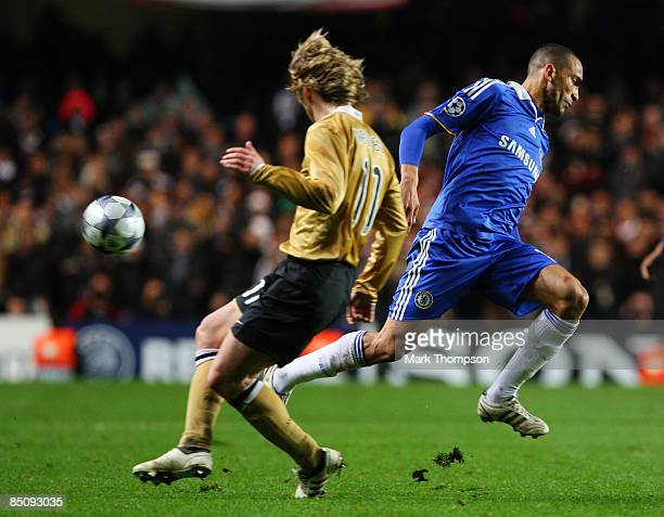 Didier Drogba of Chelsea is challenged by Pavel Nedved of Juventus during the UEFA Champions League First knockout round First Leg match between...