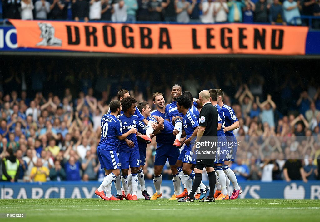 Didier Drogba of Chelsea is lifted by his team mates as he is substituted during the Barclays Premier League match between Chelsea and Sunderland at Stamford Bridge on May 24, 2015 in London, England.
