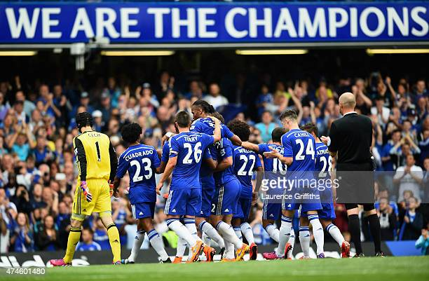 Didier Drogba of Chelsea is lifted by his team mates as he is substituted during the Barclays Premier League match between Chelsea and Sunderland at...