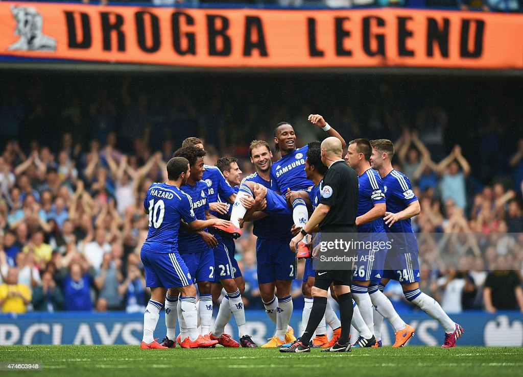 <a gi-track='captionPersonalityLinkClicked' href=/galleries/search?phrase=Didier+Drogba&family=editorial&specificpeople=179398 ng-click='$event.stopPropagation()'>Didier Drogba</a> of Chelsea is lifted by his team mates as he is substituted during the Barclays Premier League match between Chelsea and Sunderland at Stamford Bridge on May 24, 2015 in London, England.