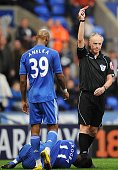 Didier Drogba of Chelsea lays on the ground as referee Peter Walton shows a red card to Boltons Jlloyd Samuel during the Barclays Premier League...