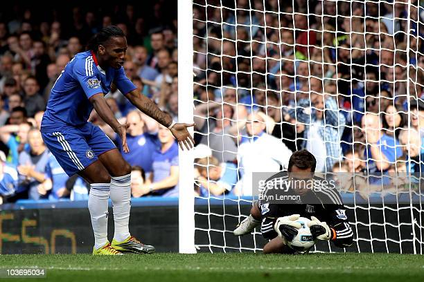 Didier Drogba of Chelsea reacts as Stoke goalkeeper Thomas Sorenson makes a save during the Barclays Premier League match between Chelsea and Stoke...