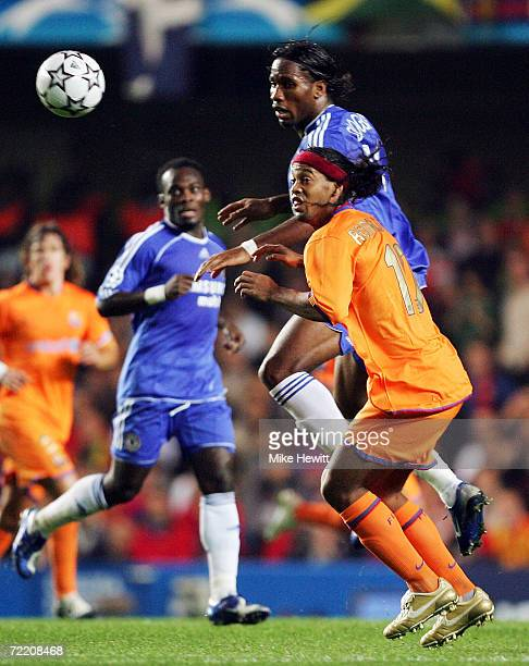 Didier Drogba of Chelsea rises above Ronaldinho of Barcelona during the UEFA Champions League Group A match between Chelsea and Barcelona at Stamford...