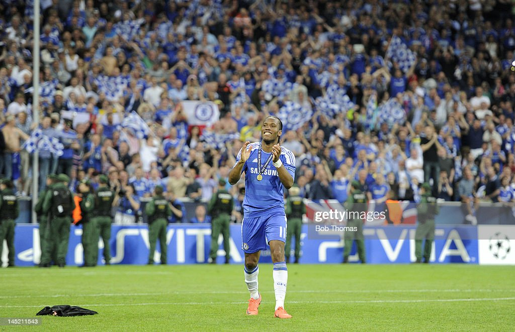 <a gi-track='captionPersonalityLinkClicked' href=/galleries/search?phrase=Didier+Drogba&family=editorial&specificpeople=179398 ng-click='$event.stopPropagation()'>Didier Drogba</a> of Chelsea salutes the fans after the UEFA Champions League Final between FC Bayern Munich and Chelsea at the Fussball Arena Munich on May 19, 2012 in Munich, Germany. The match ended 1-1 after extra time, Chelsea won 4-3 on penalties.