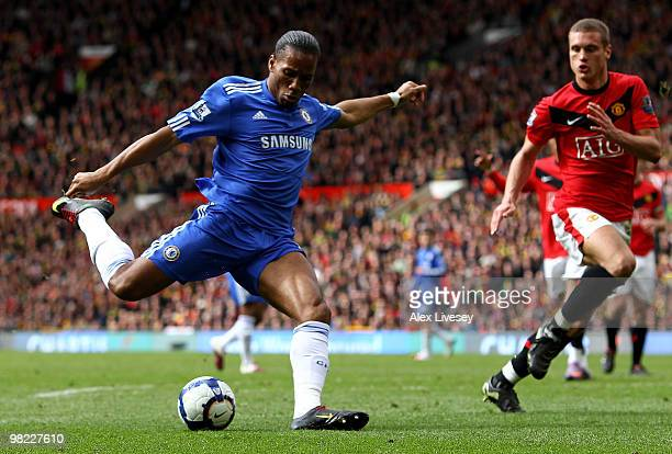 Didier Drogba of Chelsea scores his team's second goal during the Barclays Premier League match between Manchester United and Chelsea at Old Trafford...