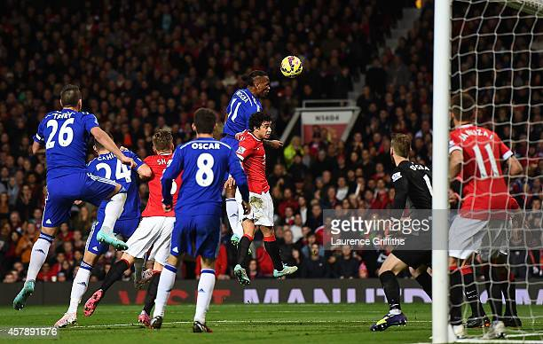 Didier Drogba of Chelsea scores the first goal during the Barclays Premier League match between Manchester United and Chelsea at Old Trafford on...