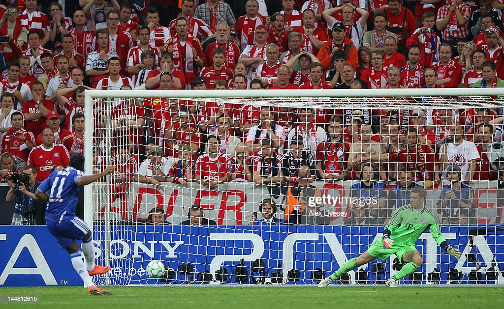 <a gi-track='captionPersonalityLinkClicked' href=/galleries/search?phrase=Didier+Drogba&family=editorial&specificpeople=179398 ng-click='$event.stopPropagation()'>Didier Drogba</a> of Chelsea scores the winning penalty against goalkeeper <a gi-track='captionPersonalityLinkClicked' href=/galleries/search?phrase=Manuel+Neuer&family=editorial&specificpeople=764621 ng-click='$event.stopPropagation()'>Manuel Neuer</a> during UEFA Champions League Final between FC Bayern Muenchen and Chelsea at the Fussball Arena München on May 19, 2012 in Munich, Germany.