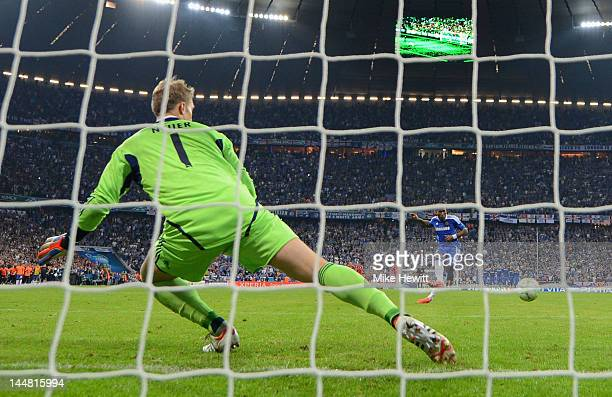 Didier Drogba of Chelsea scores the winning penalty against goalkeeper Manuel Neuer of Bayern Muenchen during UEFA Champions League Final between FC...