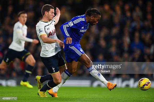 Didier Drogba of Chelsea scores their second goal under pressure from Jan Vertonghen of Spurs during the Barclays Premier League match between...