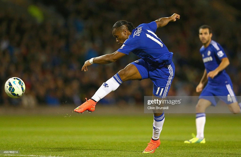 Didier Drogba of Chelsea shoots at goal during the Barclays Premier League match between Burnley and Chelsea at Turf Moor on August 18, 2014 in Burnley, England.