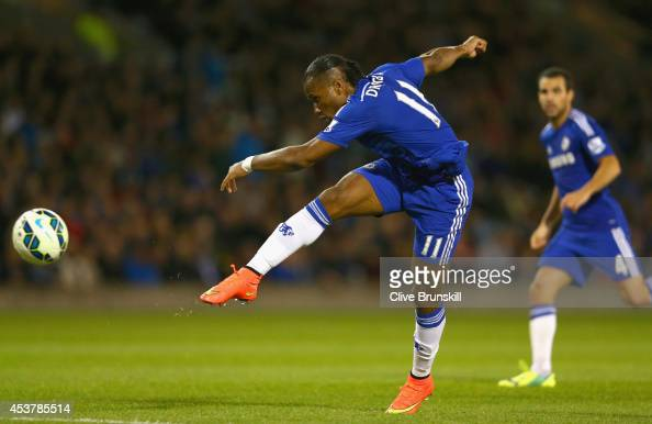 Didier Drogba of Chelsea shoots at goal during the Barclays Premier League match between Burnley and Chelsea at Turf Moor on August 18 2014 in...