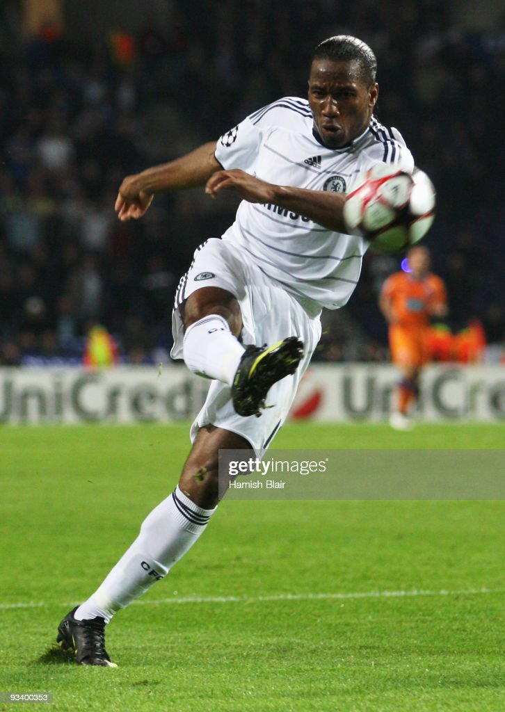 Didier Drogba of Chelsea shoots during the UEFA Champions League Group D match between FC Porto and Chelsea at the Estadio Do Dragao on November 25, 2009 in Porto, Portugal.