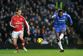 Didier Drogba of Chelsea shoots towards goal and scores as Thomas Vermaelen of Arsenal looks on during the Barclays Premier League match between...