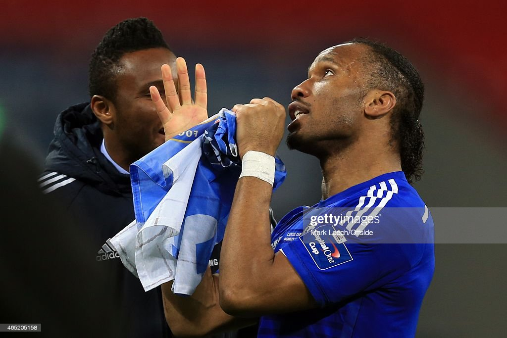 <a gi-track='captionPersonalityLinkClicked' href=/galleries/search?phrase=Didier+Drogba&family=editorial&specificpeople=179398 ng-click='$event.stopPropagation()'>Didier Drogba</a> of Chelsea sings into a Chelsea flag as John Obi Mikel looks on during the Capital One Cup Final match between Chelsea and Tottenham Hotspur at Wembley Stadium on March 1, 2015 in London, United Kingdom.