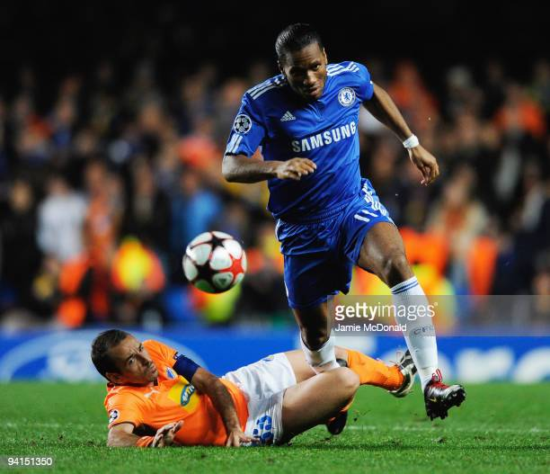 Didier Drogba of Chelsea takes on Hrysis Mihail of APOEL Nicosia during the UEFA Champions League Group D match between Chelsea and Apoel Nicosia at...
