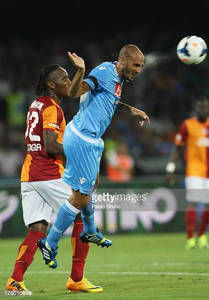 Didier Drogba of Galatasaray competes for the ball with Paolo Cannavaro of SSC Napoli during the preseason friendly match between SSC Napoli and...