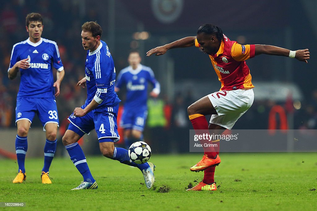 Didier Drogba (R) of Galatasaray is challenged by Benedikt Hoewedes of Schalke during the UEFA Champions League Round of 16 first leg match between Galatasaray and FC Schalke 04 at the Turk Telekom Arena on February 20, 2013 in Istanbul, Turkey.