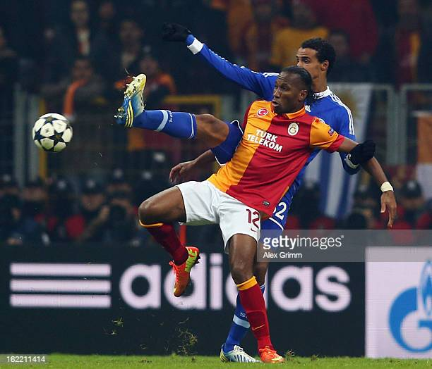 Didier Drogba of Galatasaray is challenged by Joel Matip of Schalke during the UEFA Champions League Round of 16 first leg match between Galatasaray...