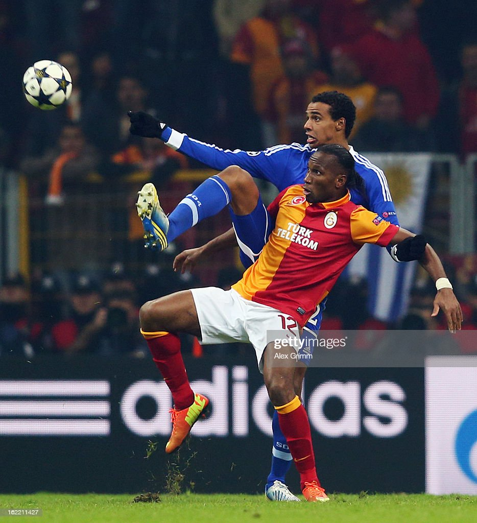 Didier Drogba (front) of Galatasaray is challenged by Joel Matip of Schalke during the UEFA Champions League Round of 16 first leg match between Galatasaray and FC Schalke 04 at the Turk Telekom Arena on February 20, 2013 in Istanbul, Turkey.